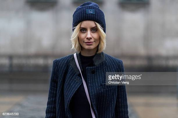 Lisa Hahnbueck wearing navy stripped Asos Pinstripe Coat a black HM Trend Rip Knit with XXL Sleeves / Big Sleeves navy Allude Cashmere Jogging Pants...