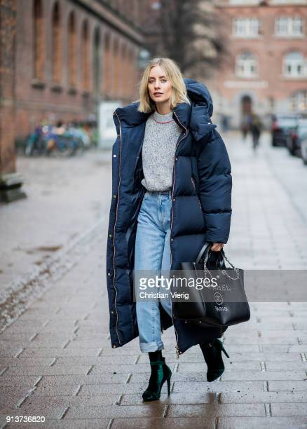 Lisa Hahnbueck wearing navy Tommy Hilfiger x Gigi Hadid down feather jacket coat Victoria Beckham knit Goldsign denim jeans Mai Piu Senza velvet...