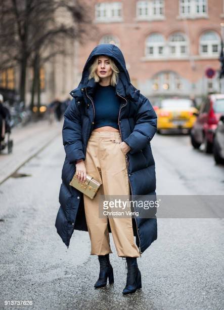 Lisa Hahnbueck wearing navy Tommy Hilfiger x Gigi Hadid down feather jacket coat Alexander Wang cropped top beige I Am Gia cropped wide leg pants...
