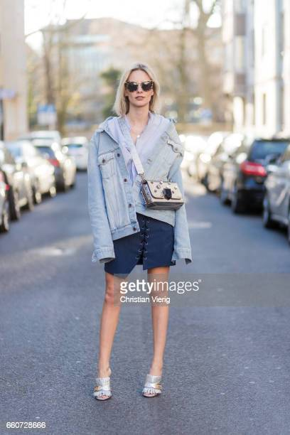 Lisa Hahnbueck wearing Off White Denim Jacket Zara Shirt Isla Asymmetric Laced Skirt gucci Heels Prada Sunglasses on March 30 2017 in Duesseldorf...