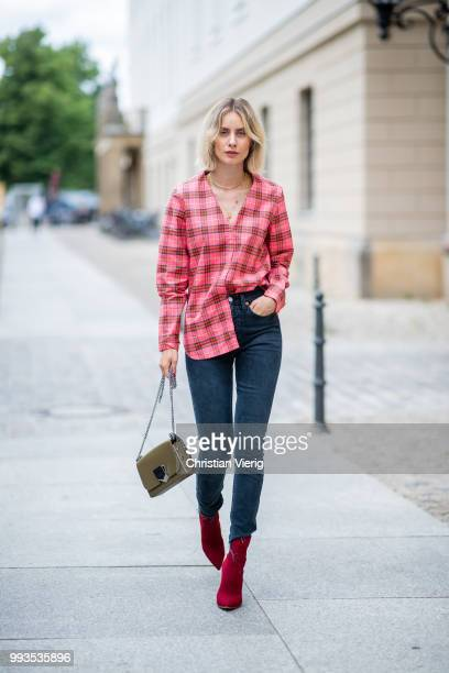 Lisa Hahnbueck wearing plaid Burberry button shirt dark blue denim jeans Levis Re/done Jimmy Choo bag Gianvito Rossi ankle boots during the Berlin...