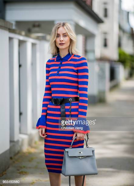 Lisa Hahnbueck wearing red blue striped Baum und Pferdgarten dress Hermes Kelly bag 28 belt Chanel sandals on May 3 2018 in Duesseldorf Germany