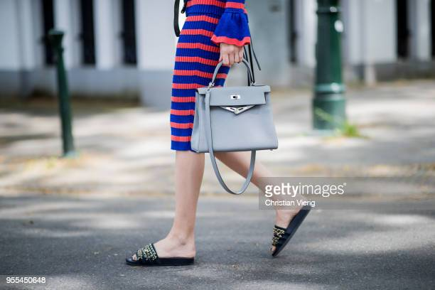 Lisa Hahnbueck wearing red blue striped Baum und Pferdgarten dress Hermes Kelly bag 28 belt Chanel sandals on May 3 2018 in Duesseldorf Germany