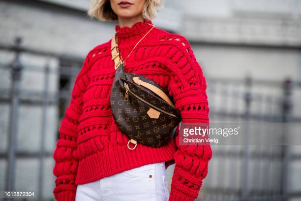 Lisa Hahnbueck wearing red Isabel Marant knit pullover Louis Vuitton Bum bag Yeezy 500 Adidas sneaker white Redone Levis jeans Ray Ban sunglasses...