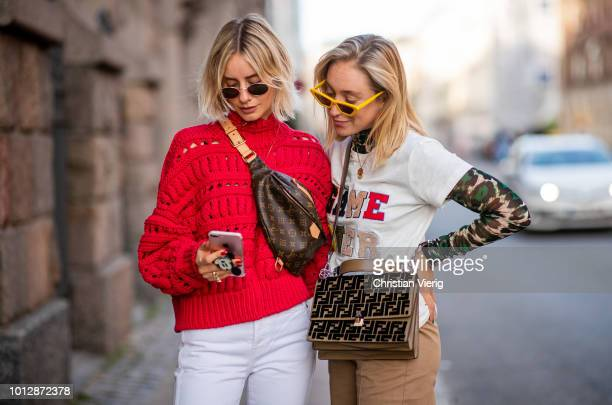 Lisa Hahnbueck wearing red Isabel Marant knit pullover, Louis Vuitton Bum bag, Yeezy 500 Adidas sneaker, white Redone Levis jeans, Ray Ban sunglasses...