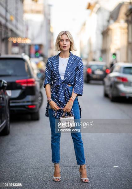 Lisa Hahnbueck wearing Redone jeans Baum und Pferdgarten belted coat Roger Vivier bag Aquazzura heels is seen outside Baum und Pferdgarten during the...