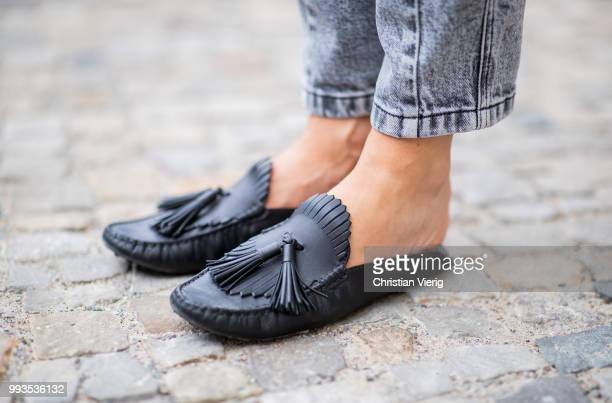 Lisa Hahnbueck wearing ruffled jumper Louis Vuitton grey denim jeans Louis Vuitton New Wave Louis Vuitton bag Tods loafers during the Berlin Fashion...