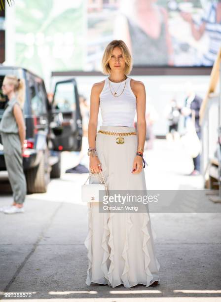 Lisa Hahnbueck wearing ruffled maxi skirt, white top, white Chanel bag seen outside Lana Mueller during the Berlin Fashion Week July 2018 on July 5,...