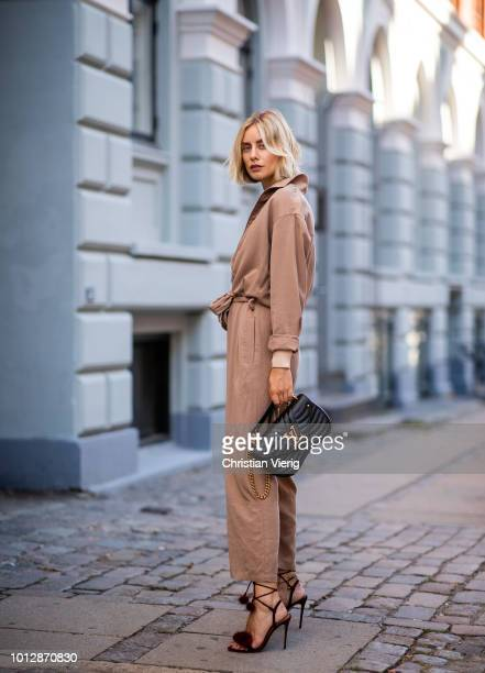 Lisa Hahnbueck wearing Samsoe Samsoe knit Samsoe Samsoe overall Aquazzura high heels Louis Vuitton New Wave bag seen during the Copenhagen Fashion...
