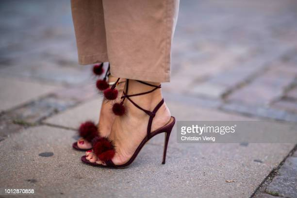 Lisa Hahnbueck wearing Samsoe Samsoe knit Samsoe Samsoe overall Aquazzura high heels Louis Vuitton New Wave bag seen during the Copenhagen Fashion...
