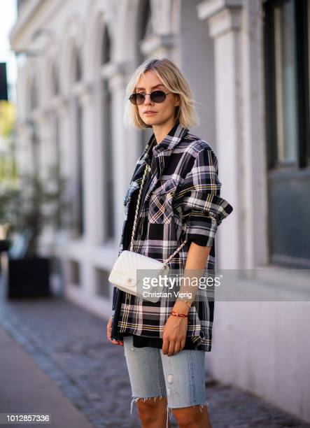 Lisa Hahnbueck wearing Samsoe Samsoe oversized checked shirt Balenciaga tshirt white Chanel bag Levis skinny jeans shorts Aquazzura high heels seen...
