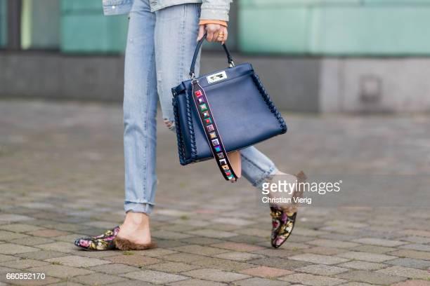 Lisa Hahnbueck wearing Sitzens of Humanity Denim Jacket Sitzens of Humanity Denim Jeans Gucci Princetown Loafer Fendi Peekaboo bag Fendi Studded...