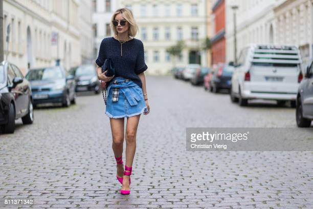 Lisa Hahnbueck wearing Strenese knit top SJYP denim skirt with belt details Christian Louboutin pink douce du desert high heels Prada sunglasses...