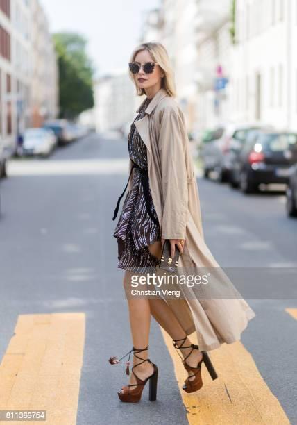 Lisa Hahnbueck wearing Strenesse maxi trench coat Louis Vuitton Sparkle dress RTW SS16 Aquazurra x Poppy Delevigne high heels Louis Vuitton Iphone...