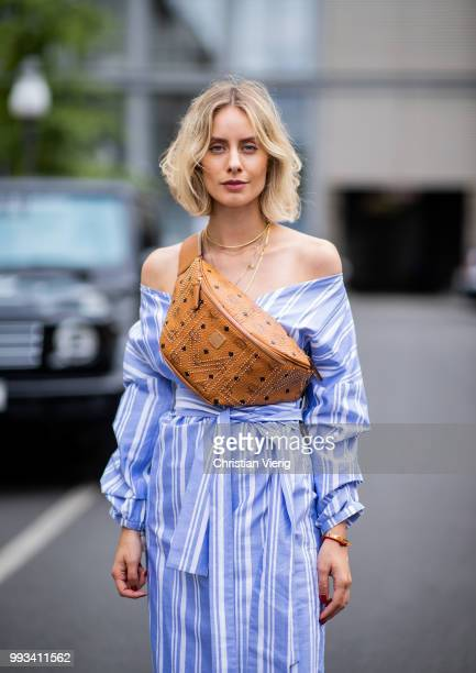Lisa Hahnbueck wearing striped off shoulder dress Mykke Hofmann MCM Stark fanny belt bag Hermes Oran sandals seen during the Berlin Fashion Week July...