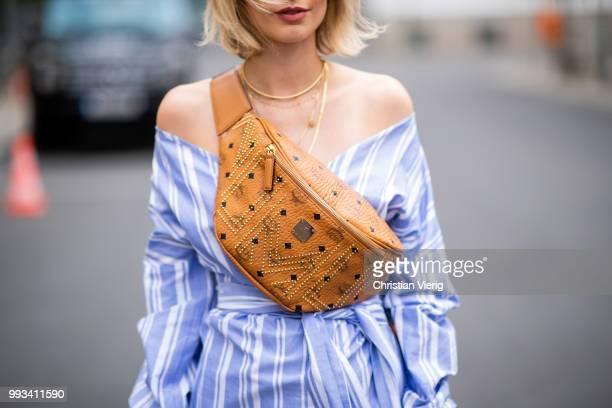 Lisa Hahnbueck wearing striped off shoulder dress Mykke Hofmann MCM Stark fanny belt bag Hermes Oran sandals seen during the Berlin Fashion Week July...