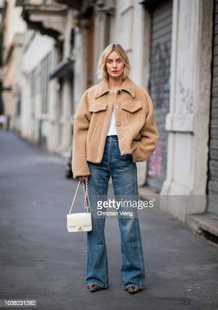 Lisa Hahnbueck wearing teddy jacket Off White white tshirt Celine denim jeans Citizens of Humanity Balenciaga boots Chanel bag is seen during Milan...
