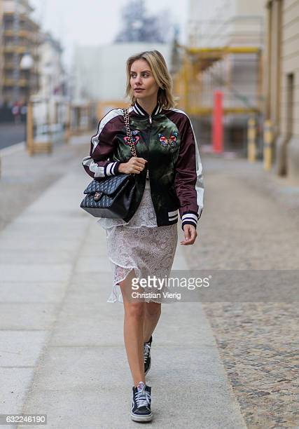 Lisa Hahnbueck wearing Velention Satin Bomber Jacket with Butterfly Patches SelfPortrait Lace Skirt with Frilles Chanel Timeless Flap Bag VANS Sk8Hi...