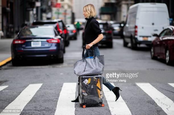 Lisa Hahnbueck wearing velvet Roger Vivier boots Re/done Levis jeans Self Portrait turtleneck Goya bag Rimowa x Off White travel bag trolley suitcase...