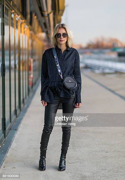 Lisa Hahnbueck wearing Victoria Beckham striped blouse with oversized ow tie Bonvirage leather pants Aigner bag Aeyde Bowie Ankle Boots patent...