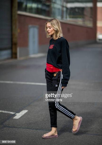 Lisa Hahnbueck wearing vintage pablo merchandise tour longsleeve black Adidas track pants red velvet Chanel fanny belt bag pink rubber slides Fendi...