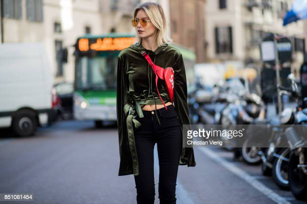 Lisa Hahnbueck wearing Y Project velvet cropped hoodie frame high waisted crop jeans yeezy boots supreme x Louis Vuitton belt bag Vogue Eyewear x...