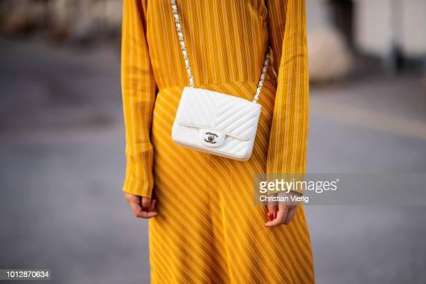 Lisa Hahnbueck wearing yellow Samsoe Samsoe dress Chanel white bag Chanel slippers seen during the Copenhagen Fashion Week Spring/Summer 2019 on...