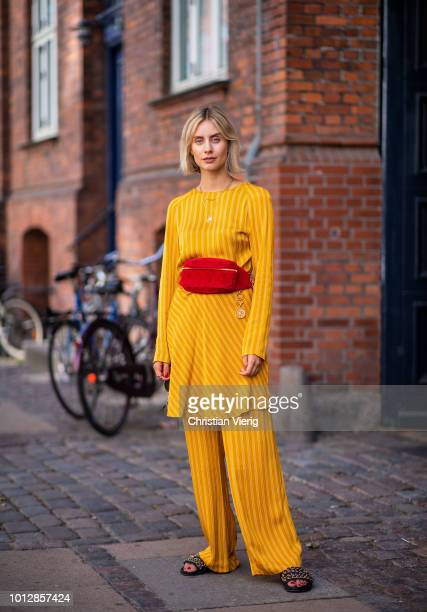 Lisa Hahnbueck wearing yellow Samsoe Samsoe suit Chanel belt bag Chanel slippers seen during the Copenhagen Fashion Week Spring/Summer 2019 on August...