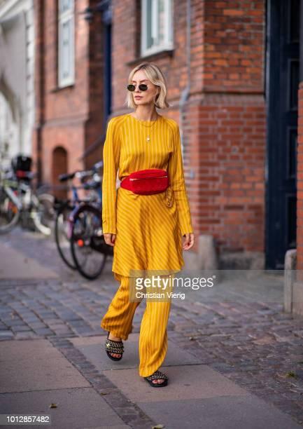 Lisa Hahnbueck wearing yellow Samsoe & Samsoe suit, Chanel belt bag, Chanel slippers seen during the Copenhagen Fashion Week Spring/Summer 2019 on...