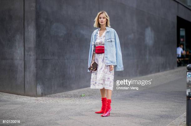 Lisa Hahnbueck wearing Zimmermann dress, a denim jeans jacket Off White, red vintage Chanel belt bag, red Balenciaga x Colette Knife boots during the...