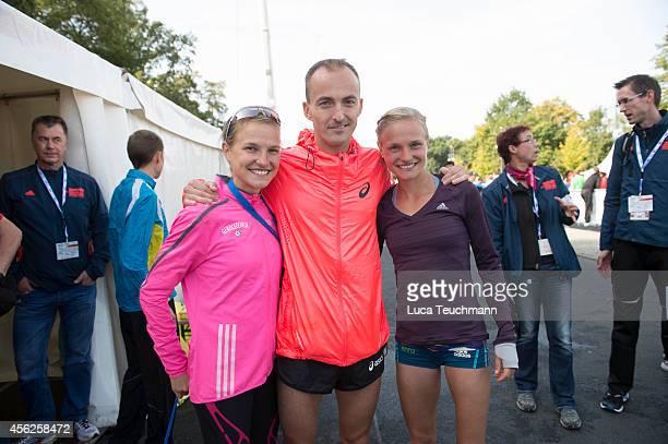Lisa Hahner ; Falk Cierpinski and Anna Hahner pose after finishing the 41th BMW Berlin Marathon on September 28, 2014 in Berlin, Germany.