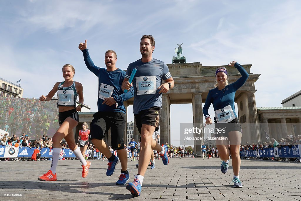 Lisa Hahner (Marathon), Johannes Lochner (Bob Pilot), Tobias Wendl (Ludge) and Miriam Goessner (Biathlon) of the BMW Wintersport relay finishing at the 43. BMW Berlin Marathon on September 25, 2016 in Berlin, Germany.