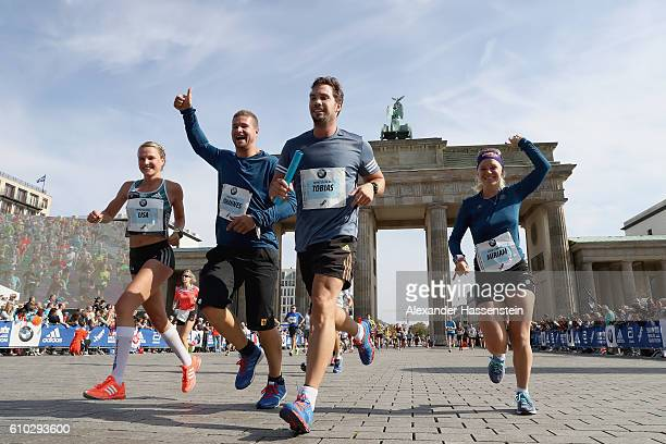 Lisa Hahner Johannes Lochner Tobias Wendl and Miriam Goessner of the BMW Wintersport relay finishing at the 43 BMW Berlin Marathon on September 25...
