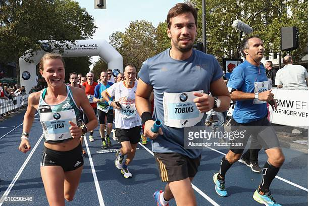 Lisa Hahner of the BMW Wintersport relay hands over to her team mate Tobias Wendl during the 43 BMW Berlin Marathon on September 25 2016 in Berlin...