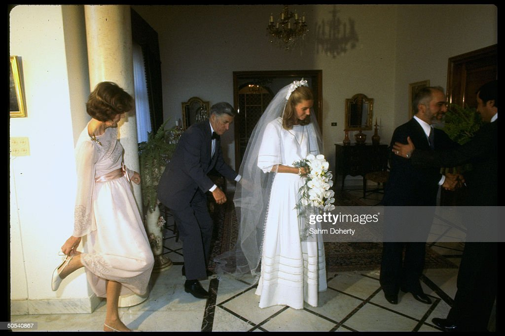 Lisa Halaby, bride of Jordan's King Hussein (2R), standing with her parents (L) Mr. and Mrs. Najeeb Halaby, on her wedding day.