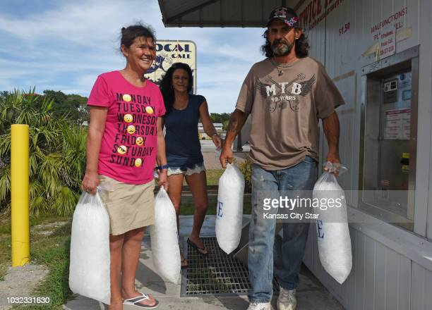 Lisa Harrelson, from left, Sheila Dennis and her husband Jimmy Dennis, all of Southport, came to Oak Island, N.C., on Wednesday, Sept. 12 to find the...