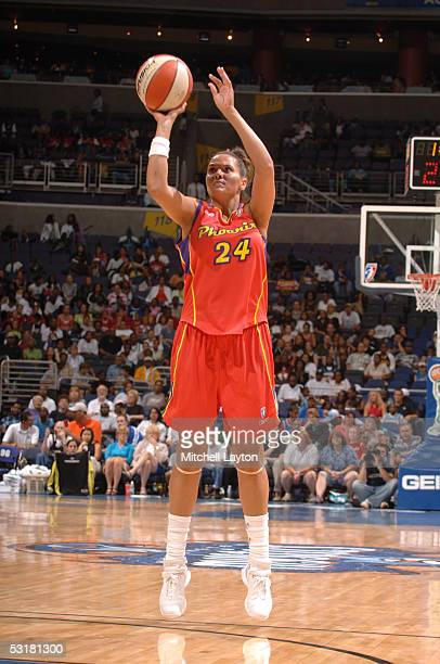 Lisa Harrison of the Phoenix Mercury attempts a shot against the Washington Mystics during a WNBA game June 21 2005 at the MCI Center in Washington...