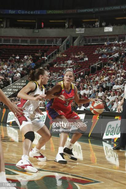 Lisa Harrison of the Phoenix Mercury is defended by Adia Barnes of the Seattle Storm during the game on July 19 2002 at Key Arena in Seattle...
