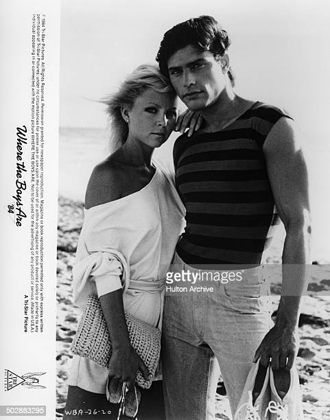 Lisa Hartman and Russell Todd pose on the beach for the TriStar movie Where the Boys Are '84 circa 1983