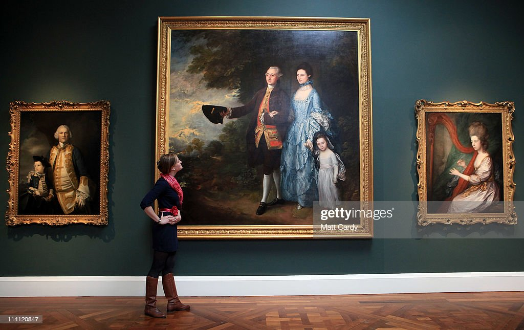 Lisa Hartung, museum volunteer and trainee curator, looks at Thomas Gainsborough's The Bayan Family at a preview of the new Holburne Museum ahead of its reopening on May 12, 2011 in Bath, England. The new museum's first exhibition - which opens to the public on Saturday - is Peter Blake: A Museum for Myself and will for the first time show extraordinary objects from Peter Blake's own collection together with a number of important works by the artist himself. The new Holburne Museum includes the restoration of its Grade I listed building and the construction of a striking new extension by Eric Parry Architects. The Museum houses a collection of fine and decorative arts built around the remarkable art collection of Sir William Holburne, first assembled in 19th century Bath, including works by Gainsborough, Zoffany and Turner.