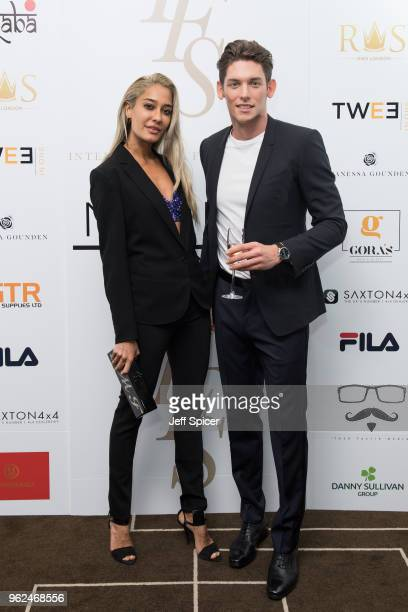 Lisa Haydon and Wes Myron attend the inaugural International Fashion Show at Rosewood Hotel on May 25 2018 in London England