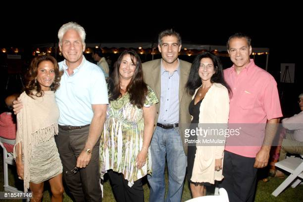 Lisa Held Michael Held Tammy Caress Jeff Caress Lydia Pedone and Pete Pedone attend 7th Annual Hamptons Happening benefiting the Samuel Waxman Cancer...