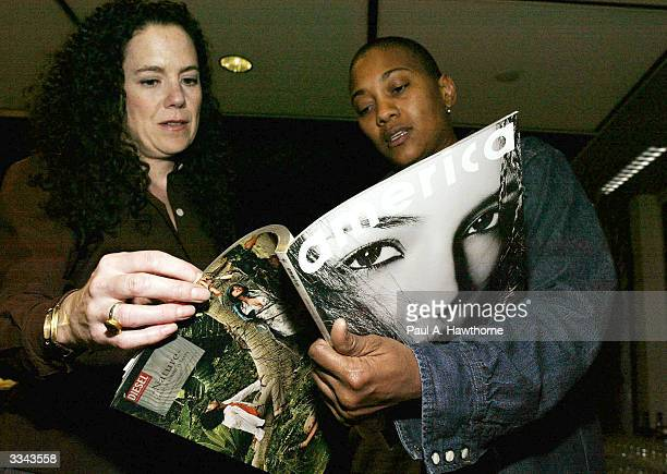 Lisa Hintelmann and Robyn Crawford look at a copy of Damon Dash's new magazine New America during a viewing of Baadasssss at the Sony Screening Room...
