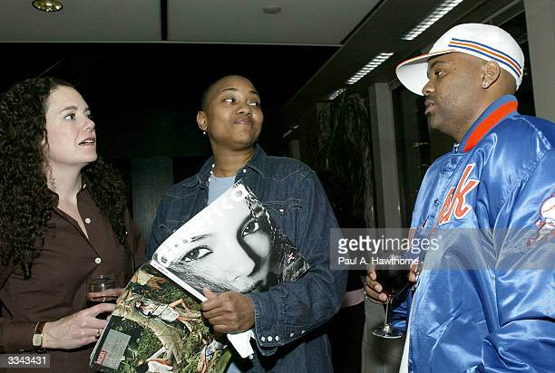 Lisa Hintelmann Robyn Crawford and CEO of RocAFella Records/Rocawear Damon Dash look at a copy of Dash's new magazine New America during a viewing of...