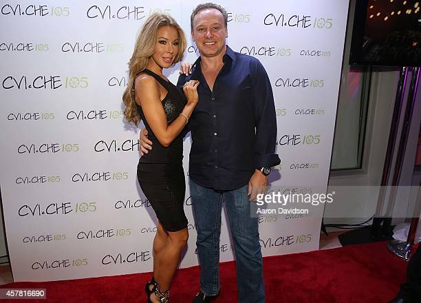 Lisa Hochstein and Leonard Hochstein attend Private Opening Reception For CVICHE 105 South Beach on October 24 2014 in Miami Florida