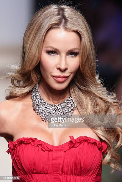 Lisa Hochstein walks the runway during Red Dress Fashion Show at Funkshion to benefit Go Red For Women on October 12 2012 in Miami Beach Florida