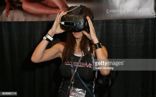 Lisa Houck demonstrates a virtual reality program at the Camasutra VR booth during the 2018 AVN Adult Expo at the Hard Rock Hotel Casino on January...
