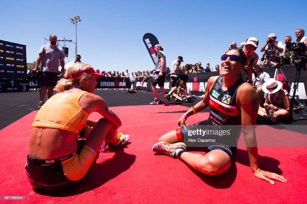 Lisa Huetthaler (R) of Austria in 1st place and Camilla Lindholm Borg (L) of Sweden in 2nd place react after finishing Ironman 70.3 Italy race on June 18, 2017 in Pescara, Italy.