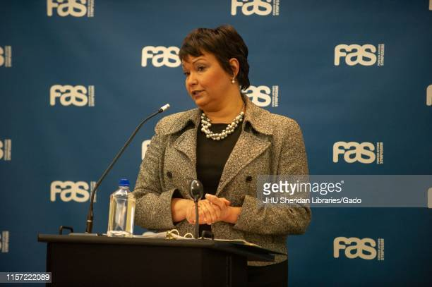 Lisa Jackson a chemical engineer and administrator from the waist up speaking from a podium during a Foreign Affairs Symposium at the Johns Hopkins...