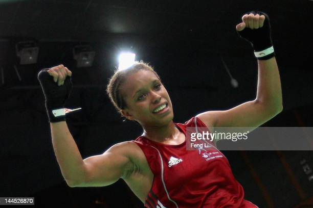 Lisa Jane Whiteside of England celebrates winning against Laishram Devi of India after the Women's 60kg preliminary match during the AIBA Women's...